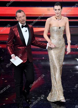 Sanremo Festival host and artistic director, Amadeus and Italian model Vittoria Ceretti on stage at the Ariston theatre during the 71st Sanremo Italian Song Festival, in Sanremo, Italy, 04 March 2021. The festival runs from 02 to 06 March.