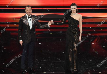 Sanremo Festival host and artistic director, Amadeus (L) and Italian model Vittoria Ceretti (R) on stage at the Ariston theatre during the 71st Sanremo Italian Song Festival, in Sanremo, Italy, 04 March 2021. The festival runs from 02 to 06 March.
