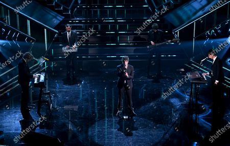Stock Picture of Italian band Lo Stato Sociale with Francesco Pannofino and the entertaiment workers perform on stage at the Ariston theatre during the 71st Sanremo Italian Song Festival, in Sanremo, Italy, 04 March 2021. The festival runs from 02 to 06 March.