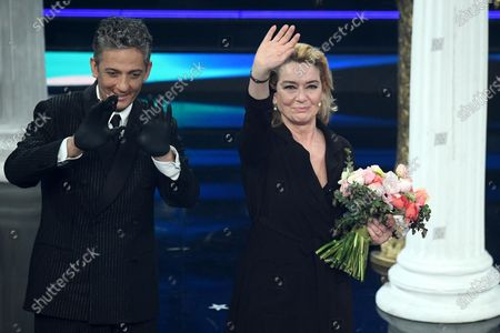 Italian showman Rosario Fiorello (L) with Italian actress Monica Guerritore (R) perform on stage at the Ariston theatre during the 71st Sanremo Italian Song Festival, in Sanremo, Italy, 04 March 2021. The festival runs from 02 to 06 March.