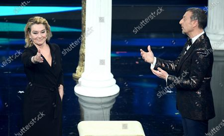 Sanremo Festival host and artistic director, Amadeus (R) with Italian actress Monica Guerritore (L) perform on stage at the Ariston theatre during the 71st Sanremo Italian Song Festival, in Sanremo, Italy, 04 March 2021. The festival runs from 02 to 06 March.