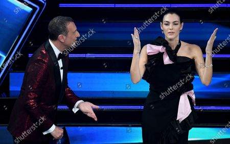Sanremo Festival host and artistic director, Amadeus (L) and Italian model Vittoria Ceretti on stage at the Ariston theater during the 71st Sanremo Italian Song Festival, in Sanremo, Italy, 04 March 2021. The festival runs from 02 to 06 March.