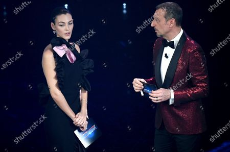 Sanremo Festival host and artistic director, Amadeus (R) and Italian model Vittoria Ceretti on stage at the Ariston theater during the 71st Sanremo Italian Song Festival, in Sanremo, Italy, 04 March 2021. The festival runs from 02 to 06 March.