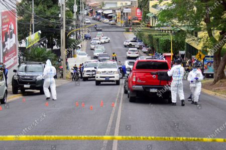 Police officers inspect the scene where lawyer Melvin Bonilla was attacked while driving on the main street of the Alameda neighborhood, in Tegucigalpa, Honduras, 04 march 2021. A Honduran lawyer who was a judge in the courts of law in the capital of Honduras was shot dead while driving in his car in a central area of Tegucigalpa.