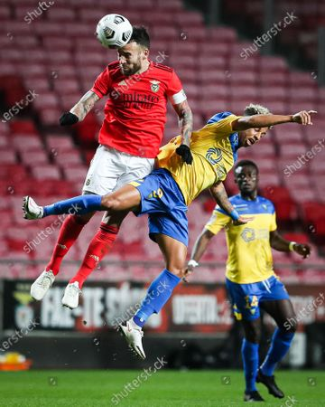 Benfica player Nicolas Otamendi (L) vies for the ball with Estoril Praia player Andre Vidigal during their second leg of Portugal Cup semi final soccer match held at Luz Stadium, in Lisbon, Portugal, 04 March 2021.