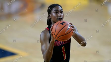 Maryland guard Diamond Miller plays during the first half of an NCAA college basketball game, in Ann Arbor, Mich