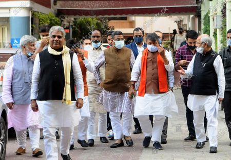 """BJP delegation comprising Dharmendra Pradhan, Bhupender Yadav, Om Pathak, Shishir Bhajoria, Neeraj Kumar and Dr. Sanjay Mayukh coming out after meet ECI today at Nirvachan Sadan on March 4, 2021 in New Delhi, India. A delegation of BJP on Thursday met Election Commission of India in Delhi. Addressing the media, BJP's Bhupender Yadav said, """"Term of 125 municipal corporations in West Bengal including Kolkata Municipal Corporation ended a year ago. But State Govt appointed TMC leaders as administrators of these local bodies. These administrators should be removed to ensure free and fair polls."""" BJP also complained of few police officers alleging their relations with TMC."""