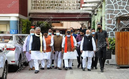 """Stock Picture of BJP delegation comprising Dharmendra Pradhan, Bhupender Yadav, Om Pathak, Shishir Bhajoria, Neeraj Kumar and Dr. Sanjay Mayukh coming out after meet ECI today at Nirvachan Sadan on March 4, 2021 in New Delhi, India. A delegation of BJP on Thursday met Election Commission of India in Delhi. Addressing the media, BJP's Bhupender Yadav said, """"Term of 125 municipal corporations in West Bengal including Kolkata Municipal Corporation ended a year ago. But State Govt appointed TMC leaders as administrators of these local bodies. These administrators should be removed to ensure free and fair polls."""" BJP also complained of few police officers alleging their relations with TMC."""