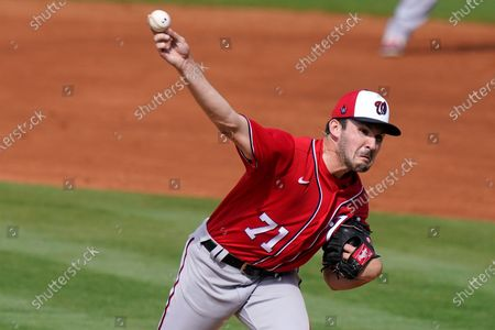 Washington Nationals relief pitcher Henry Cole (71) throws during a spring training baseball game against the New York Mets, in Port St. Lucie, Fla