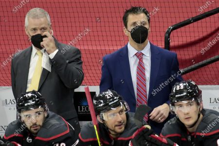 Carolina Hurricanes' head coach Rod Brind'Amour, top right, and assistant coach Jeff Daniels watch the action as the team plays against the Detroit Red Wings during the third period of an NHL hockey game in Raleigh, N.C., . AP Photo/Chris Seward