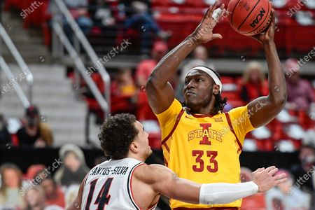 Iowa State's Solomon Young (33) attempts to shoot over Texas Tech's Marcus Santos-Silva (14) during the first half of an NCAA college basketball game in Lubbock, Texas