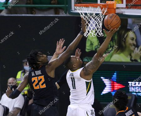 Baylor guard Mark Vital (11) scores past Oklahoma State forward Kalib Boone (22) in the first half of an NCAA college basketball game, in Waco, Texas