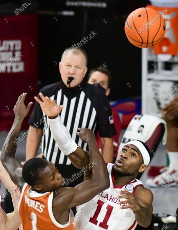 Oklahoma forward De'Vion Harmon (11) blocks a shot by Texas guard Andrew Jones (1) during the first half of an NCAA college basketball game in Norman, Okla