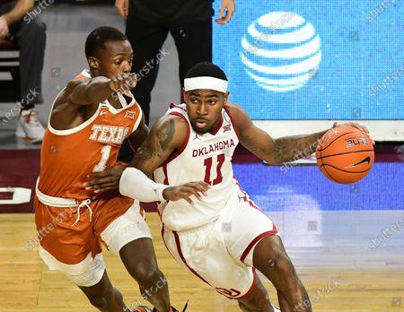 Oklahoma guard De'Vion Harmon (11) drives past Texas guard Andrew Jones (1) during the first half of an NCAA college basketball game in Norman, Okla