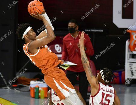 Texas forward Kai Jones (22) shoots the ball over Oklahoma guard Alondes Williams (15) during the first half of an NCAA college basketball game in Norman, Okla
