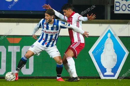 Stock Image of Lasse Schone (SC Heerenveen) duels Edson Alvarez of Ajax during KNVB cup match SC Heerenveen-Ajax