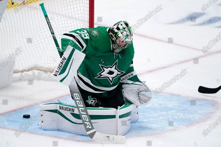 Dallas Stars goaltender Anton Khudobin is unable to stop a goal by Columbus Blue Jackets' Eric Robinson during the third period of an NHL hockey game in Dallas