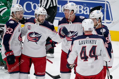 Columbus Blue Jackets' Emil Bemstrom (52), Oliver Bjorkstrand (28), Riley Nash (20), Vladislav Gavrikov (44) and Michael Del Zotto, right, celebrate a goal by Bjorkstrand during the third period of an NHL hockey game against the Dallas Stars in Dallas