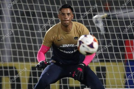Pumas' goalkeeper Alfredo Talavera warms up prior to a Mexican soccer league match against Santos at University Olympic Stadium in Mexico City