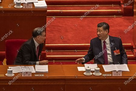 Chinese President Xi Jinping (R) talks to Chairman of the Chinese People's Political Consultative Conference (CPPCC) Wang Yang (L) during the opening session of the National People's Congress (NPC) at the Great Hall of the People, in Beijing, China, 05 March 2021. China holds two major annual political meetings, The National People's Congress (NPC) and the Chinese People's Political Consultative Conference (CPPCC) which run alongside and together known as 'Lianghui' or 'Two Sessions'.