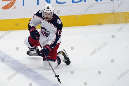 Columbus Blue Jackets defenseman Michael Del Zotto attempts to gain control of the puck during an NHL hockey game against the Dallas Stars in Dallas