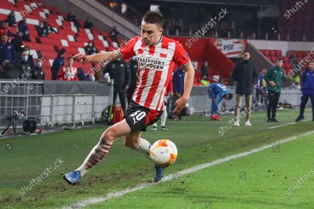 Ryan Thomas #30 of PSV with the ball  during the UEFA Europa League match between PSV v Olympiakos Piraeus at the Philips Stadium on February 25, 2021 in Eindhoven Netherlands.