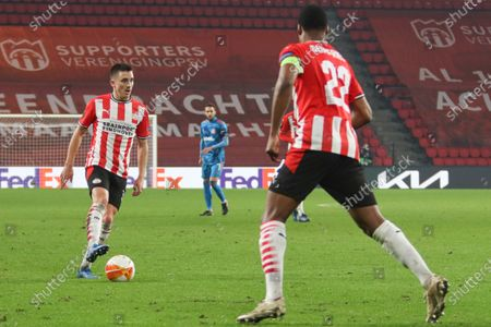 Stock Image of Ryan Thomas #30 of PSV with the ball  during the UEFA Europa League match between PSV v Olympiakos Piraeus at the Philips Stadium on February 25, 2021 in Eindhoven Netherlands.