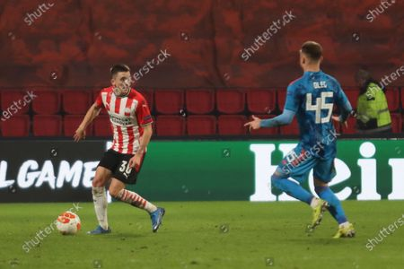 Stock Photo of (L-R) Ryan Thomas #30 of PSV, Oleg Reabciuk #45 of Olympiakos  during the UEFA Europa League match between PSV v Olympiakos Piraeus at the Philips Stadium on February 25, 2021 in Eindhoven Netherlands.