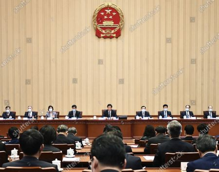Li Zhanshu, chairman of the National People's Congress (NPC) Standing Committee, presides over the first meeting of the presidium for the fourth session of the 13th NPC at the Great Hall of the People in Beijing, capital of China, March 4, 2021.