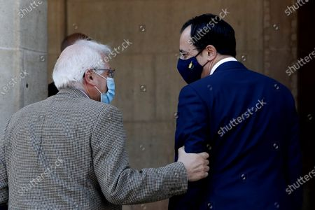 European Union foreign policy chief Josep Borrell, left, talks with Cyprus foreign minister Nikos Christodoulides prior to a meeting with Cyprus' president Nicos Anastasiades at the presidential palace in capital Nicosia, Cyprus, . Borrell is in Cyprus for two-days official visit