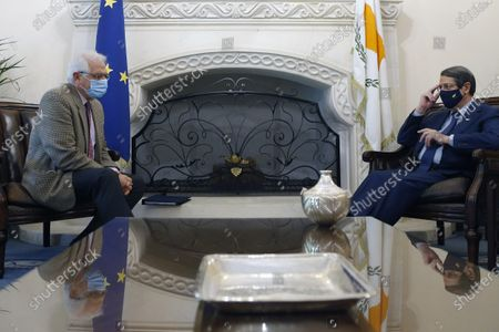European Union foreign policy chief Josep Borrell, left, talks with Cyprus Foreign Minister Nikos Christodoulides during their meeting with Cyprus' president Nicos Anastasiades at the presidential palace in capital Nicosia, Cyprus, . Borrell is in Cyprus for two-days official visit