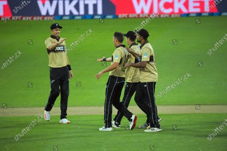 NZ's Trent Boult celebrates bowing Ashton Agar during the 4th international men's T20 cricket match between the New Zealand Black Caps and Australia at Sky Stadium in Wellington, New Zealand