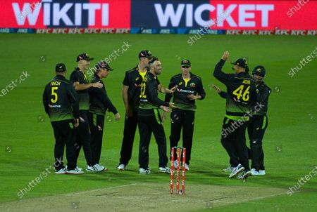 Australia celebrates Mitch Marsh catching Kane Williamson off Glenn Maxwell during the 4th international men's T20 cricket match between the New Zealand Black Caps and Australia at Sky Stadium in Wellington, New Zealand on Friday, 5 March 2021.