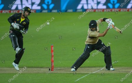 NZ's Glenn Phillips swings and misses as the ball bounces off Matthew wade during the 4th international men's T20 cricket match between the New Zealand Black Caps and Australia at Sky Stadium in Wellington, New Zealand on Friday, 5 March 2021.