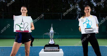 Karolina Pliskova & Kristyna Pliskova of the Czech Republic paint the Dubai Duty Free Tennis Championships trophy at the 2021 Dubai Duty Free Tennis Championships WTA 1000 tournament
