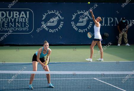 Karolina Pliskova & Kristyna Pliskova of the Czech Republic playing doubles at the 2021 Dubai Duty Free Tennis Championships WTA 1000 tournament