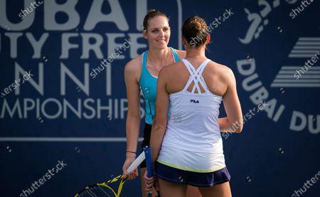 Stock Image of Karolina Pliskova & Kristyna Pliskova of the Czech Republic playing doubles at the 2021 Dubai Duty Free Tennis Championships WTA 1000 tournament