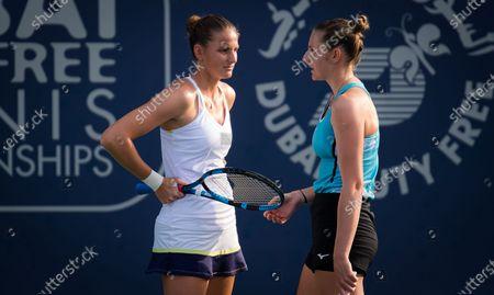 Stock Picture of Karolina Pliskova & Kristyna Pliskova of the Czech Republic playing doubles at the 2021 Dubai Duty Free Tennis Championships WTA 1000 tournament