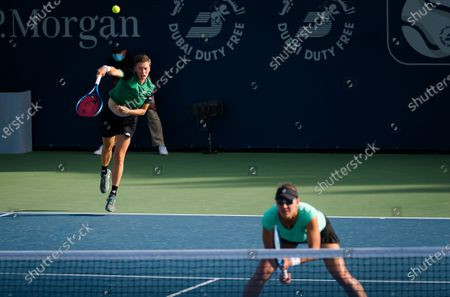 Demi Schuurs of the Netherlands & Nicole Melichar of the United States playing doubles at the 2021 Dubai Duty Free Tennis Championships WTA 1000 tournament