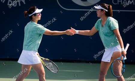 Yifan Xu & Zhaoxuan Yang of China playing doubles at the 2021 Dubai Duty Free Tennis Championships WTA 1000 tournament