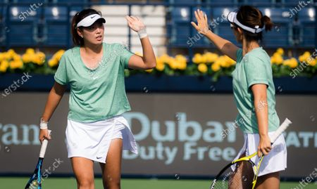 Stock Picture of Yifan Xu & Zhaoxuan Yang of China playing doubles at the 2021 Dubai Duty Free Tennis Championships WTA 1000 tournament