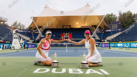 Stock Image of Alexa Guarachi of Chile & Darija Jurak of Croatia with their doubles champions trophies after the doubles final at the 2021 Dubai Duty Free Tennis Championships WTA 1000 tournament