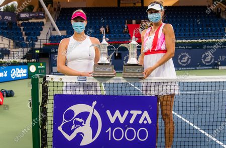 Stock Photo of Alexa Guarachi of Chile & Darija Jurak of Croatia with their doubles champions trophies after the doubles final at the 2021 Dubai Duty Free Tennis Championships WTA 1000 tournament