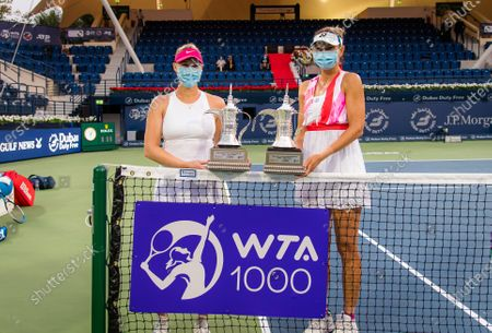 Stock Picture of Alexa Guarachi of Chile & Darija Jurak of Croatia with their doubles champions trophies after the doubles final at the 2021 Dubai Duty Free Tennis Championships WTA 1000 tournament