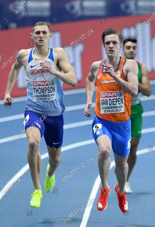 Lee Thompson (L) of Britain and Tony van Diepen (R) of the Netherlands compete in the men's 400m heats at the 36th European Athletics Indoor Championships at the Arena Torun, in Torun, north-central Poland, 05 March 2021.