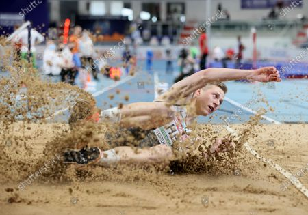 Stock Photo of Max Hess of Germany competes in the men's Triple Jump qualification  at the 36th European Athletics Indoor Championships at the Arena Torun, in Torun, north-central Poland, 05 March 2021.