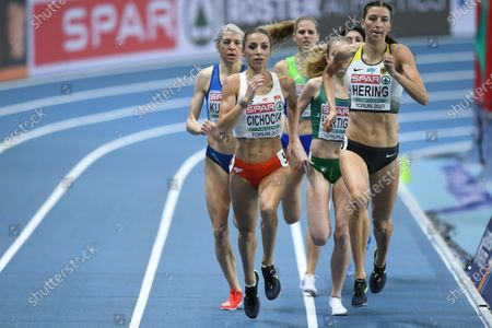 Angelika Cichocka (L) of Poland and Christina Hering (R) of Germany compete in the women's 800m heats at the 36th European Athletics Indoor Championships at the Arena Torun, in Torun, north-central Poland, 05 March 2021.