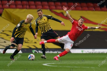 Stock Photo of Anthony Knockaert of Nottingham Forest (28) is brought down by Will Hughes of Watford (19) and Philip Zinckernagel of Watford (7)