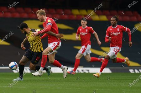 Joe Worrall of Nottingham Forest (4) grabs Andre Gray of Watford (18)