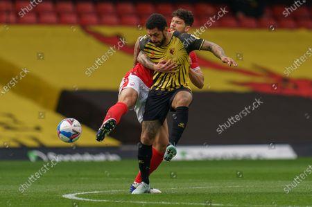 Andre Gray of Watford (18) and Tobias Figueiredo of Nottingham Forest (3)